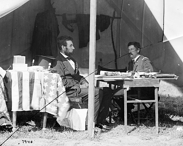President Lincoln and George McClellan following the battle of Antietam, 1862, in a tent near the battlefield